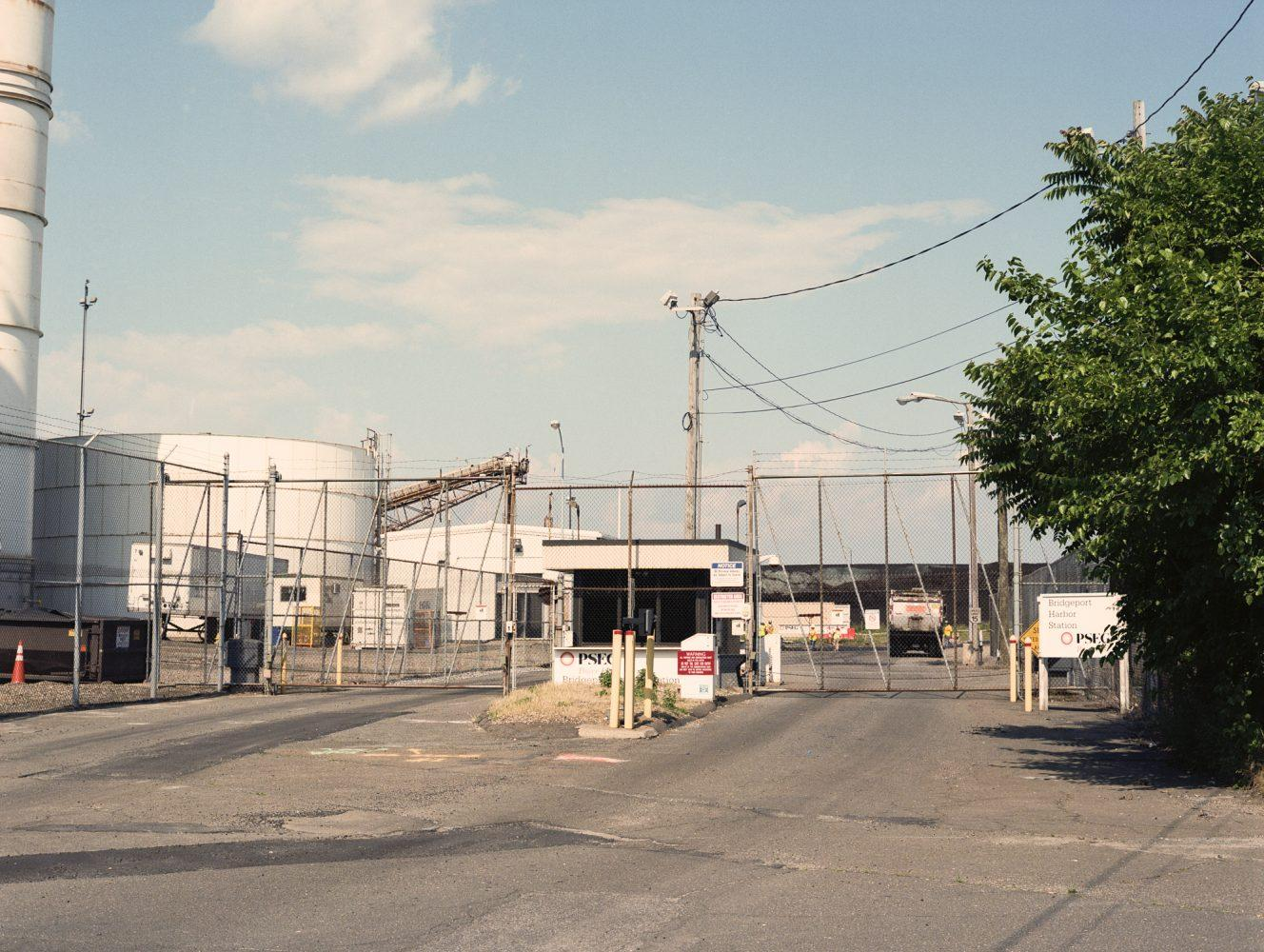Entrance to the PSEG power plant in Bridgeport, Conn., surrounded by barbed wire fencing.