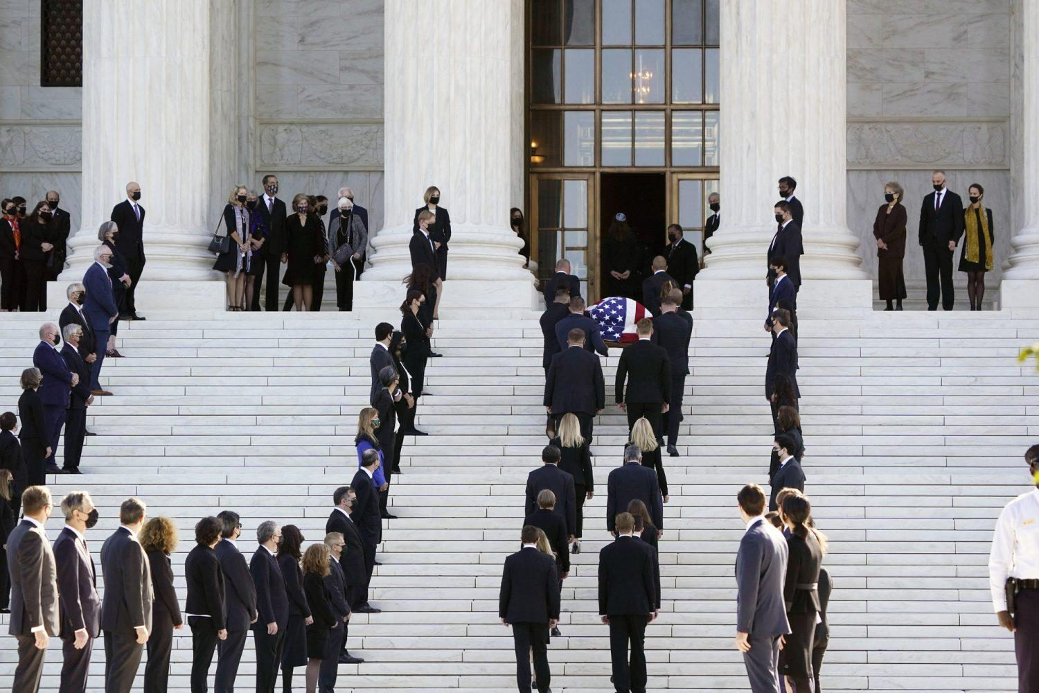 Photo of the flag-draped casket of Justice Ruth Bader Ginsburg arriving at the steps of the Supreme Court building in Washington D.C., on Wednesday, Sept. 23, 2020.