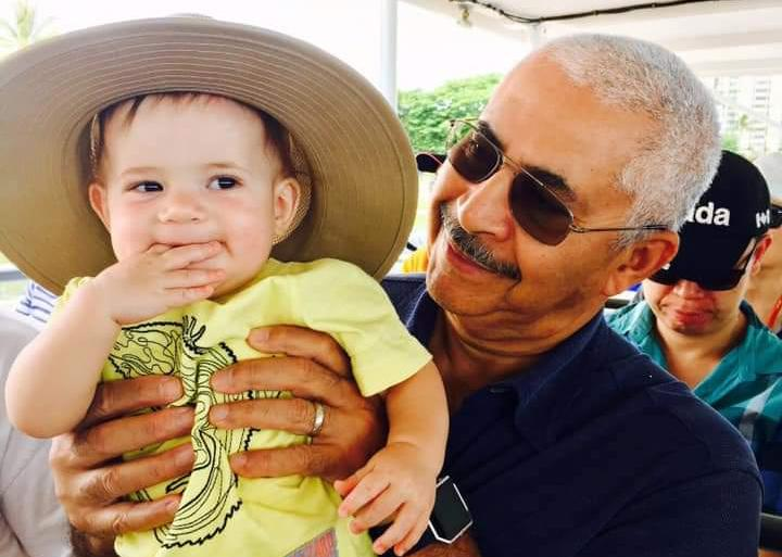 Photo of Waldemar Gonzalez, late father of Earthjustice attorney Julian Gonzalez, holding his grandchild.