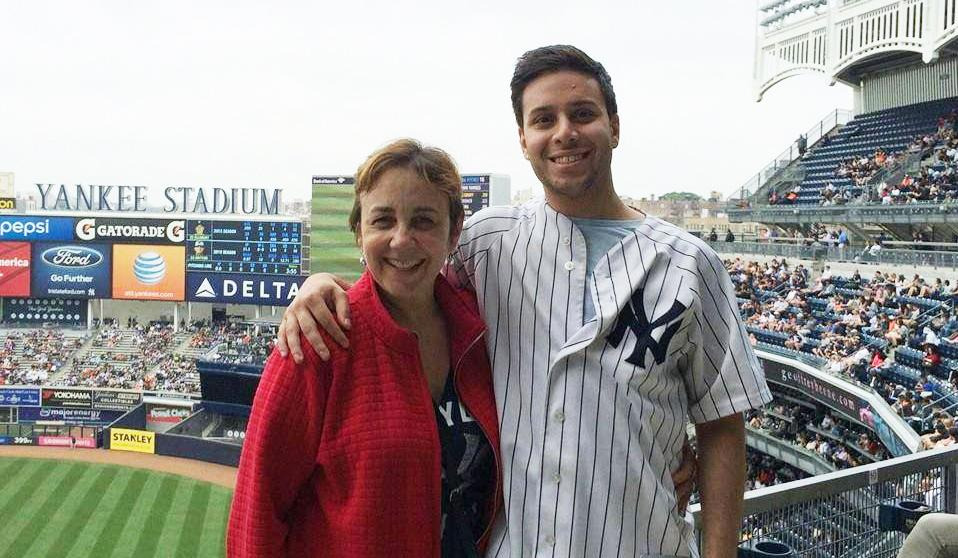 Photo of Earthjustice attorney Julian Gonzalez with his mother at Yankee Stadium.