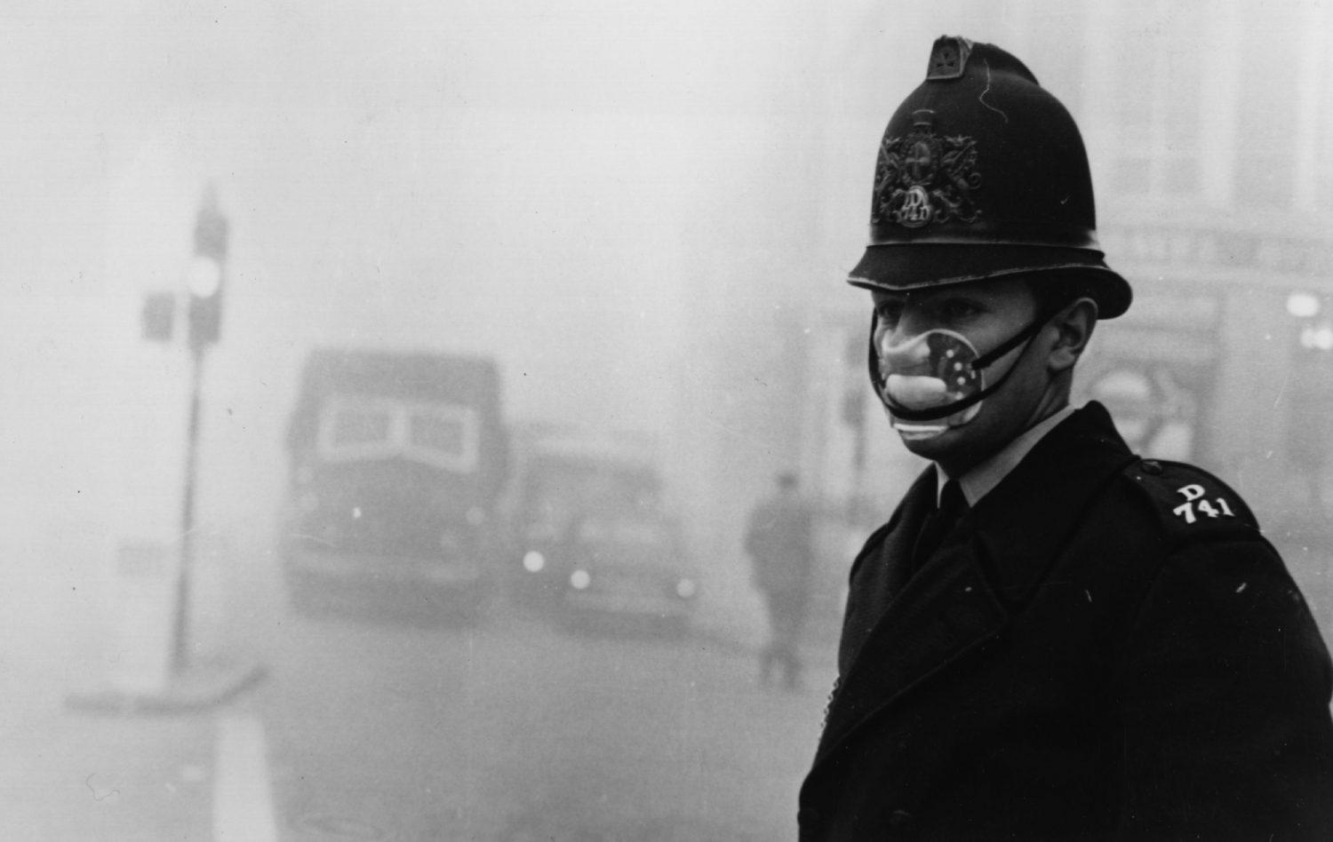 A London police officer wears a mask for protection against the Great Smog of 1952.