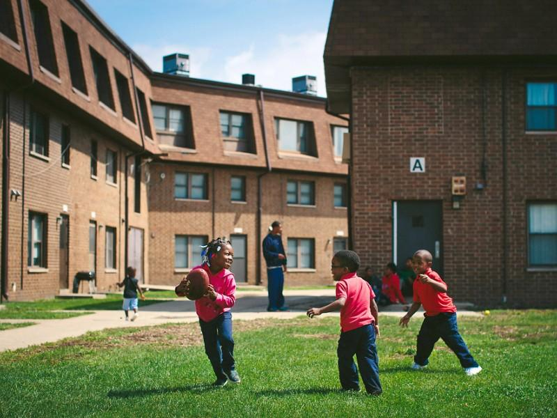 Photo of children playing in a yard at the West Calumet Housing Complex in East Chicago, Ind., on August 24, 2016.