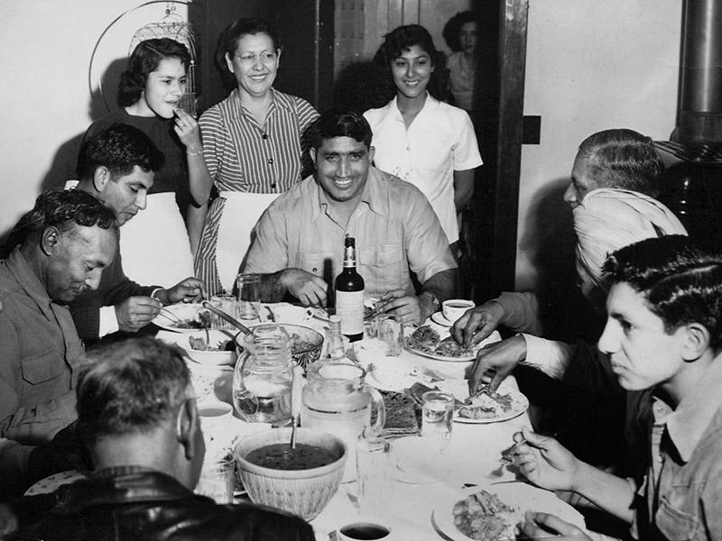 Dinner at the Phoenix home of Rosa and Jiwan Singh in 1951. At center is their guest, Indian professional wrestler Tiger Joginder Singh.