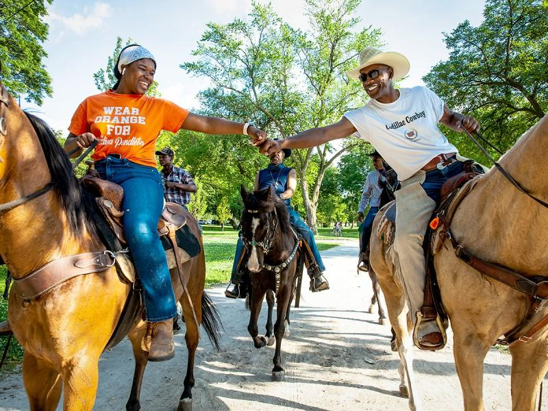 Black horse owners ride through Chicago's Washington Park for a Juneteenth celebration on June 19, 2020.