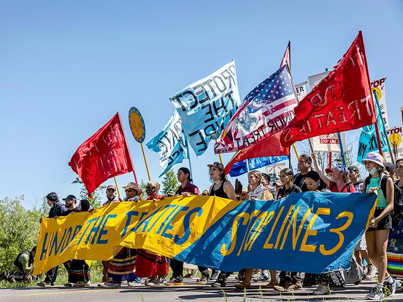 Climate activists and Indigenous community members rally against the Line 3 pipeline in Solway, Minnesota, on June 7, 2021.