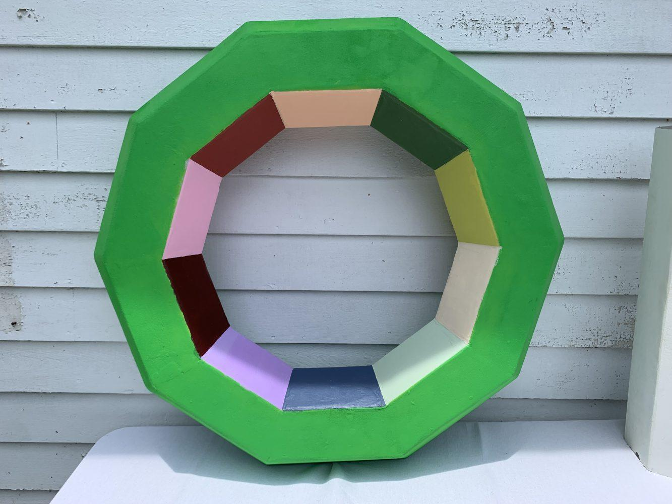 Caroline Armijo constructred this decagon from a coal ash encapsulated hexagonal-shaped post.